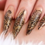 Stiletto Nails mit Gold